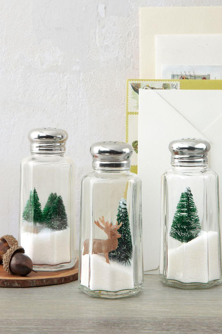 <p>Who doesn't love a good holiday shaker? Show off your creativity by turning basic salt and pepper shakers into eye-catching holiday decor. Place everything from deer to evergreens inside your shakers for a cheery holiday look. </p>