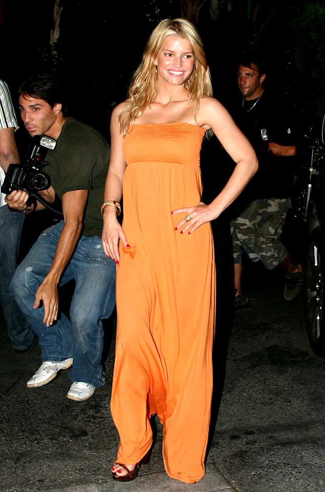 """Jessica Simpson looks radiant in orange after having dinner with friends at Mexicali in L.A. Rodrigo Marques/<a href=""""http://www.splashnewsonline.com"""" target=""""new"""">Splash News</a> - July 3, 2007"""