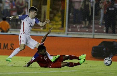 Football Soccer - Panama v USA - World Cup 2018 Qualifiers - Rommel Fernandez stadium, Panama city, 28/3/17.Christian Pulisic of the U.S. and Luis Ovalle of Panama in action. REUTERS/Juan Carlos Ulate