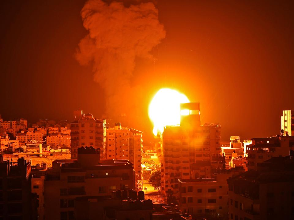 <p>An Israeli airstrike on Gaza City during the early hours of Monday</p> (AFP)