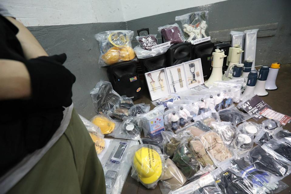 Police display a cache of explosives, protest gear and pro-independence materials seized during a raid of the premises rented by defendant Louis Lo. Photo: Felix Wong