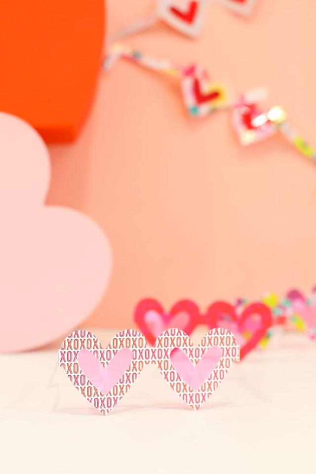 """<p>You always see life through rose-colored glasses when you're with your special someone — which is why the two of you should make this fun Valentine's Day craft. Even if you don't wear them for long, these frames will create the perfect photo. </p><p><em><a href=""""https://lovelyindeed.com/we-made-you-rose-colored-glasses-for-valentines-day/"""" target=""""_blank"""">Get the tutorial at Lovely Indeed »</a></em></p>"""