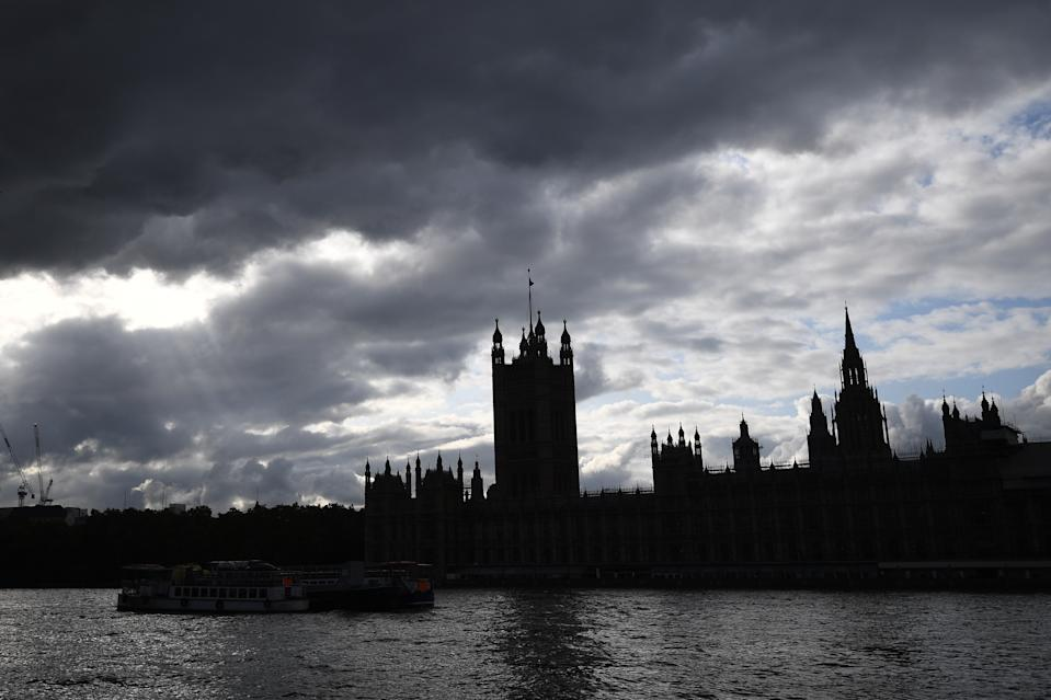 General view of the Palace of Westminster in shadow as dark clouds gather over Parliament.