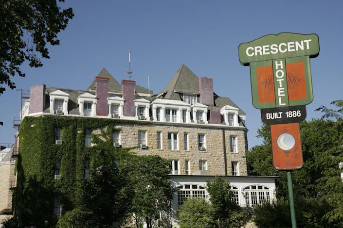 """<p>Located in Eureka Springs, Arkansas, the <a href=""""https://crescent-hotel.com/"""" rel=""""nofollow noopener"""" target=""""_blank"""" data-ylk=""""slk:Crescent Hotel"""" class=""""link rapid-noclick-resp"""">Crescent Hotel</a> is said to be an extremely haunted spot in America that may even have a <a href=""""http://crescent-hotel.com/blog/tag/americas-most-haunted-hotel/"""" rel=""""nofollow noopener"""" target=""""_blank"""" data-ylk=""""slk:portal to the &quot;other side.&quot;"""" class=""""link rapid-noclick-resp"""">portal to the """"other side.""""</a> Legend says radio personality and inventor Norman G. Baker bought it in 1937 and used it as a hospital to treat cancer patients... even though he had no training. Naturally, people allegedly died. Visitors have reported seeing the ghosts of Baker's patients and of Morris, a cat that used to live in the hotel and is buried behind it.</p>"""