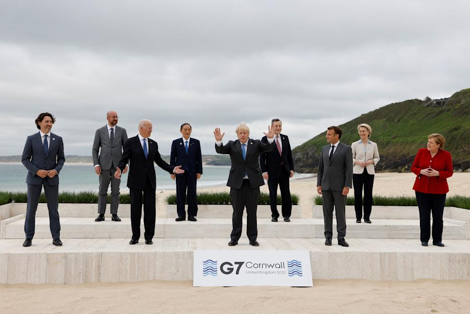 TOPSHOT - (L-R) Canada's Prime Minister Justin Trudeau, President of the European Council Charles Michel, US President Joe Biden, Japan's Prime Minister Yoshihide Suga, Britain's Prime Minister Boris Johnson, Italy's Prime minister Mario Draghi, France's President Emmanuel Macron, President of the European Commission Ursula von der Leyen and Germany's Chancellor Angela Merkel pose for the family photo at the start of the G7 summit in Carbis Bay, Cornwall on June 11, 2021. - G7 leaders from Canada, France, Germany, Italy, Japan, the UK and the United States meet this weekend for the first time in nearly two years, for three-day talks in Carbis Bay, Cornwall. (Photo by Ludovic MARIN / AFP) (Photo by LUDOVIC MARIN/AFP via Getty Images)