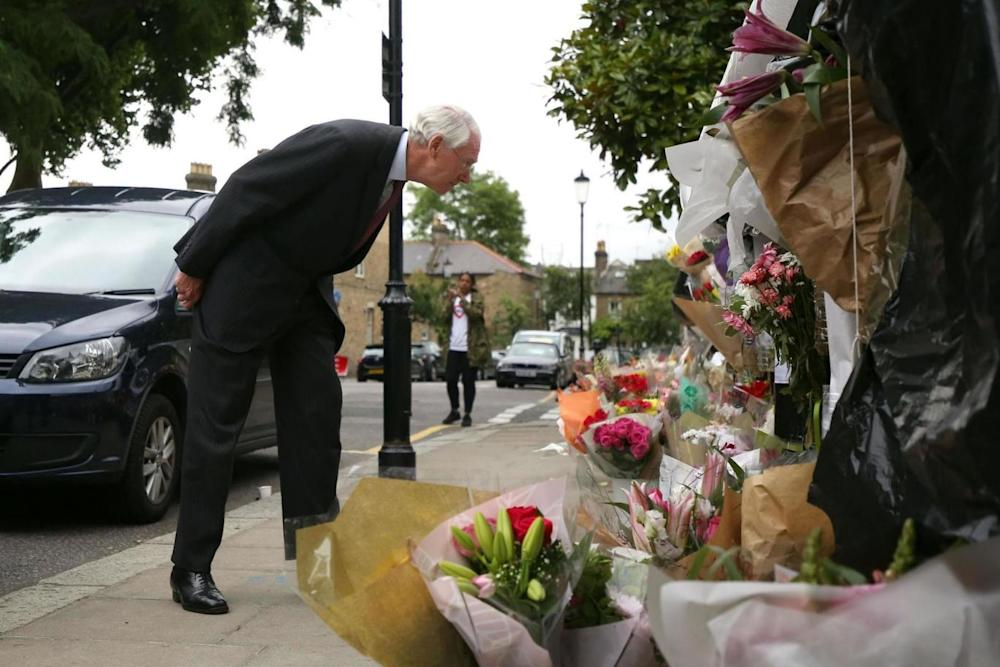 Sir Martin Moore-Bick visiting the scene of the Grenfell Tower inquiry (PA)
