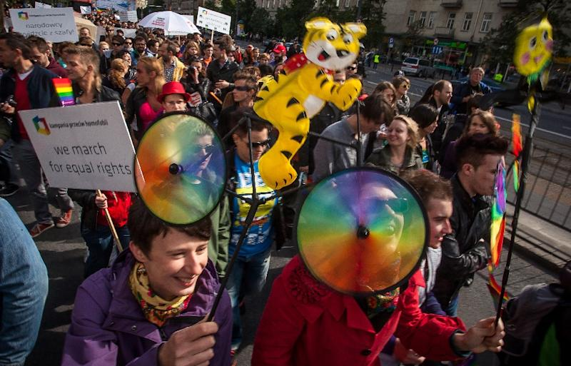People take part in a gay pride parade in Warsaw