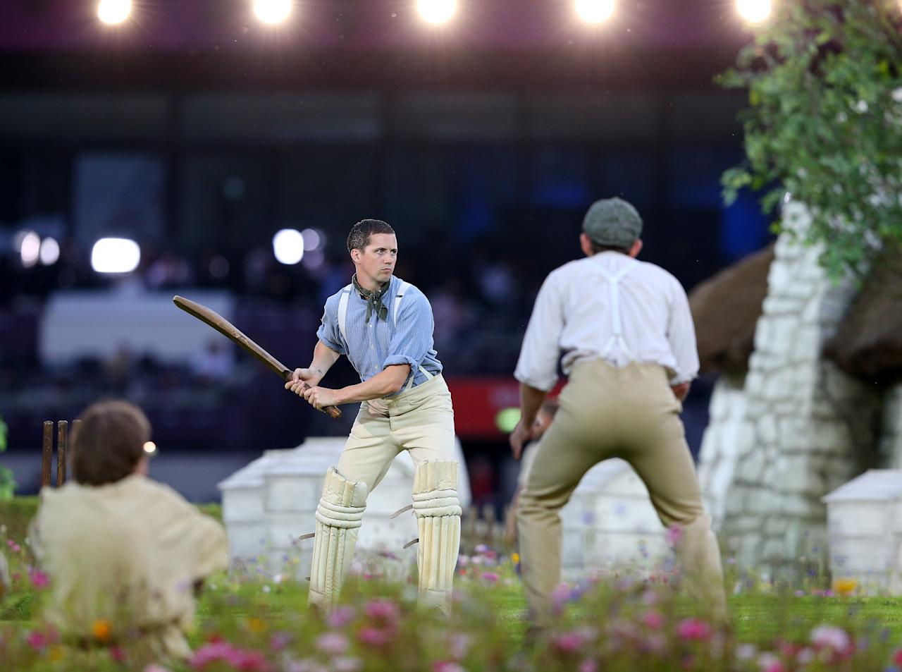 LONDON, ENGLAND - JULY 27:  Performers depict a view of the English countryside by playing a game of cricket during the Opening Ceremony of the London 2012 Olympic Games at the Olympic Stadium on July 27, 2012 in London, England.  (Photo by Cameron Spencer/Getty Images)