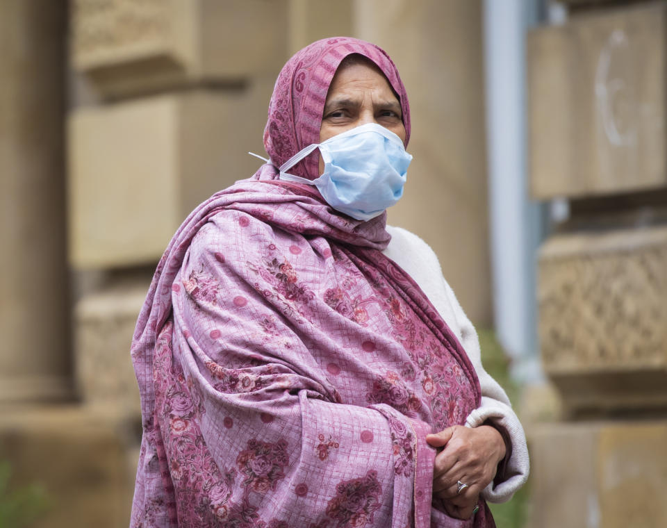 A member of the public wears a face mask in, Bradford in Yorkshire, after Health Secretary Matt Hancock published a new review which found black, Asian and minority ethnic (BAME) people are at significantly higher risk of dying from Covid-19. (Photo by Danny Lawson/PA Images via Getty Images)
