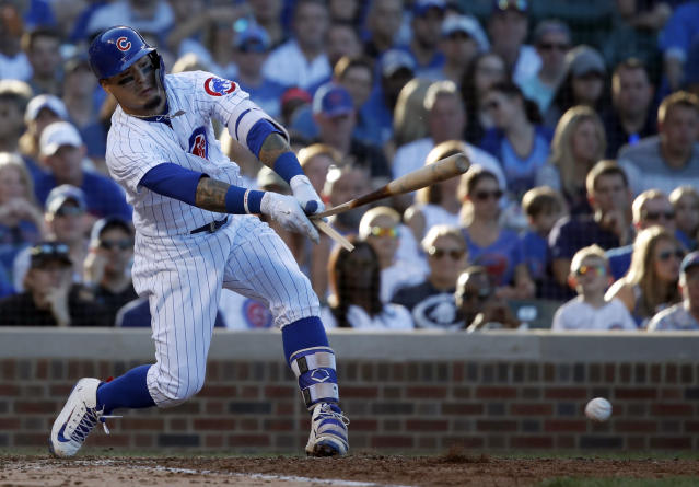 Chicago Cubs' Javier Baez breaks his bat against the Cincinnati Reds during the eighth inning of a baseball game in Chicago, on Saturday, Sept. 15, 2018. (AP Photo/Jeff Haynes)
