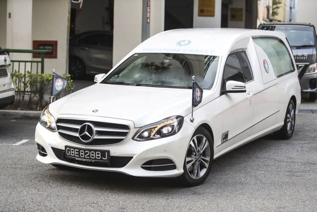 The hearse leaves the Singapore funeral parlour