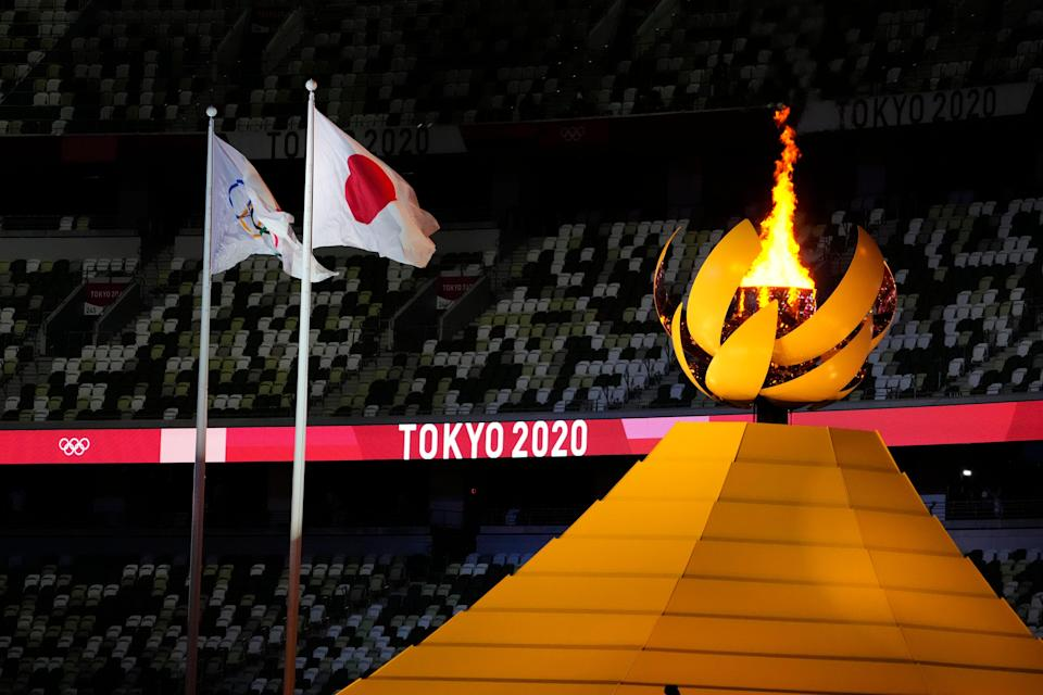 The Olympic cauldron is lit during the opening ceremony for the Tokyo 2020 Olympic Summer Games at Olympic Stadium.