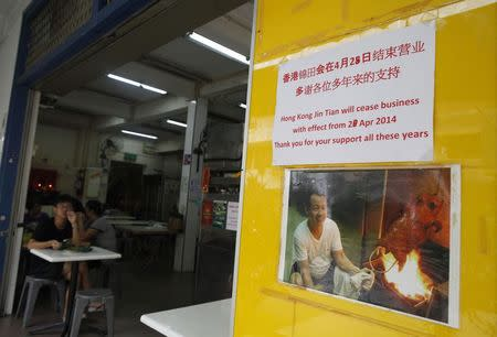 A man eats a meal at the Hong Kong Jin Tian Eating House in Singapore April 17, 2014. REUTERS/Edgar Su