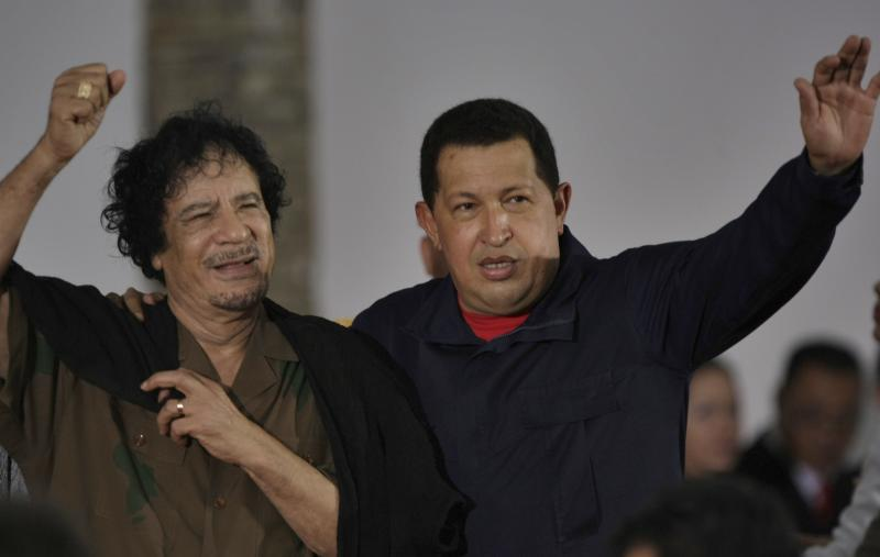FILE.- In this Sept. 28, 2009 file photo, Libya's President Moammar Gadhafi, left, and Venezuela's President Hugo Chavez wave upon their arrival to the old port in Porlamar, on Margarita Island, Venezuela.  As Gadhafi finds himself increasingly alone internationally, he still has at least a few friends far away. Venezuela's Hugo Chavez, Cuba's Fidel Castro and Nicaragua's Daniel Ortega have been foremost in opposing U.S. and NATO military involvement, and in suggesting that reports of atrocities by Gadhafi's troops are overblown or unproven. (AP Photo/Fernando Llano, File)