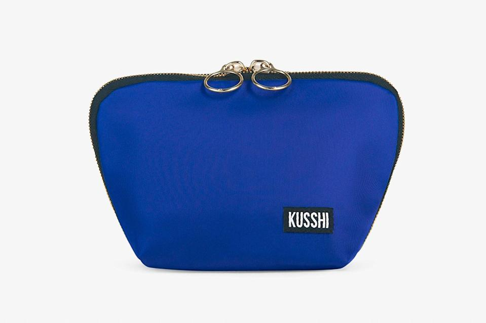 """From the water-resistant, brightly colored inner lining and trio of interior pockets to the compact, flat-bottomed shape and three-sided zipper, every last detail of this makeup bag has been cleverly designed for trouble-free rummaging and organization. It's also great for rounding up chargers, earbuds, face masks, and all other daily WFH or in-flight essentials. $45, Kusshi. <a href=""""https://www.kusshi.com/collections/all/products/everyday-makeup-bag?variant=32326080561237"""" rel=""""nofollow noopener"""" target=""""_blank"""" data-ylk=""""slk:Get it now!"""" class=""""link rapid-noclick-resp"""">Get it now!</a>"""