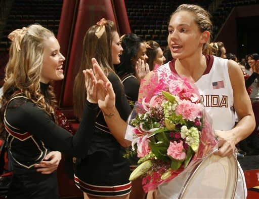 Florida State guard Alexa Deluzio, right, who made a game-winning free throw, is congratulated by a cheerleader after an NCAA college basketball game against Maryland, Thursday, Feb. 28, 2013, in Tallahassee, Fla. Florida State upset Maryland 72-71. (AP Photo/Phil Sears)