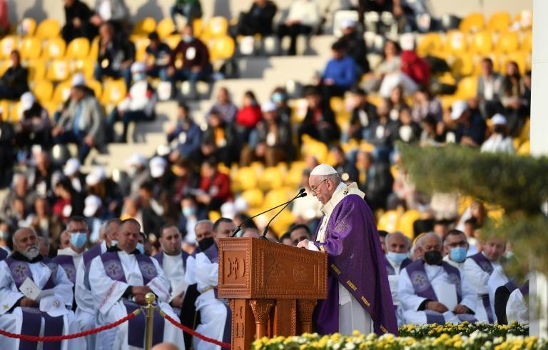 Pope Francis gives the homily during a mass at the Franso Hariri Stadium in Arbil