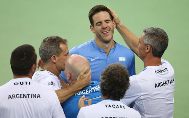 <span>Del Potro is mobbed after beating Marin Cilic in the 2016 Davis Cup final</span>