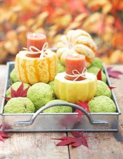 """<div class=""""caption-credit""""> Photo by: StyleCaster</div>We love this use of unexpected color and texture in a autumn centerpiece. Set some easy-to-make gourd candleholders alongside other natural fall elements in a tray for a beautiful table decoration. <br> Image Via Better Homes and Gardens"""