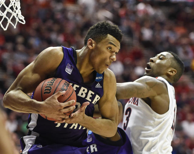 Weber State's Joel Bolomboy rips a rebound away from Arizona forward Rondae Hollis-Jefferson during the second half in a second-round game in the NCAA college basketball tournament Friday, March 21, 2014, in San Diego. (AP Photo/Denis Poroy)