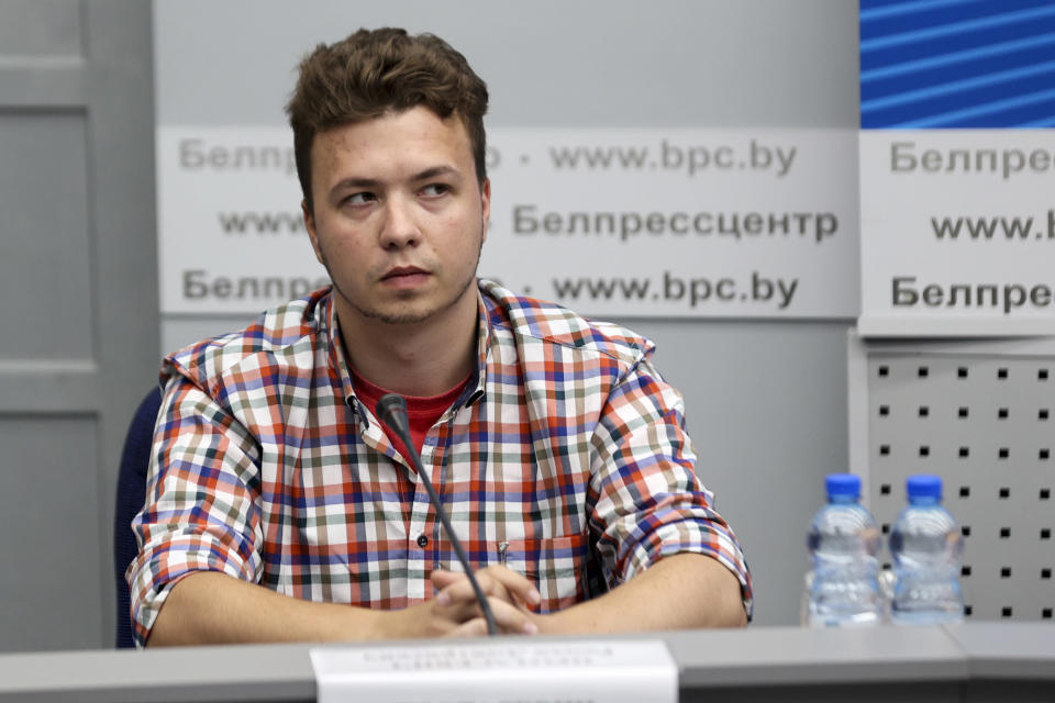 FILE In this file photo taken on Monday, June 14, 2021, Belarusian dissident journalist Raman Pratasevich attends a news conference at the National Press Center of Ministry of Foreign Affairs in Minsk, Belarus. The dissident Belarusian journalist and his Russian girlfriend who were arrested after their airline flight was diverted to Minsk last month have been moved from jail to house arrest. Raman Pratasevich, who ran a messaging app channel that was widely used in last year's massive protests against President Alexander Lukashenko, and his Russian girlfriend Sofia Sapega were seized on May 23 when their flight from Greece to Lithuania was diverted to Minsk. (Ramil Nasibulin/BelTA pool photo via AP, File)
