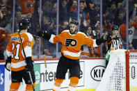 Philadelphia Flyers' Kevin Hayes (13) celebrates with Scott Laughton (21) after scoring a goal during the second period of an NHL hockey game against the San Jose Sharks, Tuesday, Feb. 25, 2020, in Philadelphia. (AP Photo/Matt Slocum)