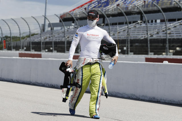 Driver Austin Dillon walks to his car for the start of the NASCAR Cup Series auto race Sunday, May 17, 2020, in Darlington, S.C. (AP Photo/Brynn Anderson)