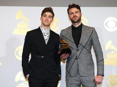 The Chainsmokers pose with the award they won for Best Dance Recording at the 59th Annual Grammy Awards in Los Angeles