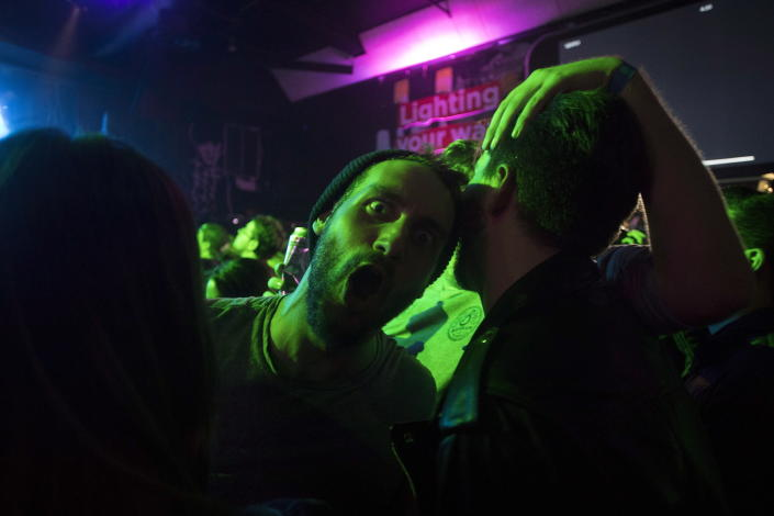 <p>People celebrate at Leafly's countdown party as midnight passes and marks the first day of the legalization of cannabis across Canada in Toronto on Wednesday, Oct. 17, 2018. (Photo: Chris Young/The Canadian Press via AP) </p>