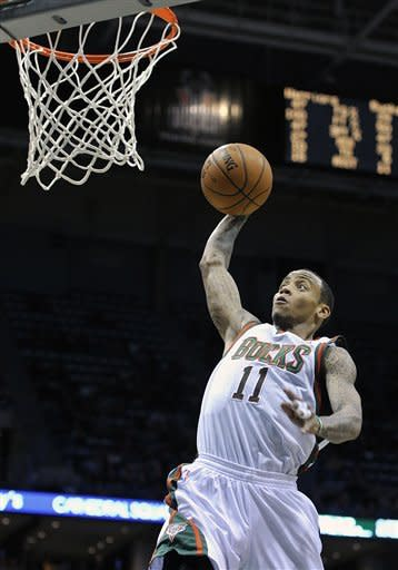 Milwaukee Bucks' Monta Ellis (11) dunks the ball against the Golden State Warriors during the second half of an NBA basketball game on Saturday, Jan. 26, 2013, in Milwaukee. (AP Photo/Jim Prisching)