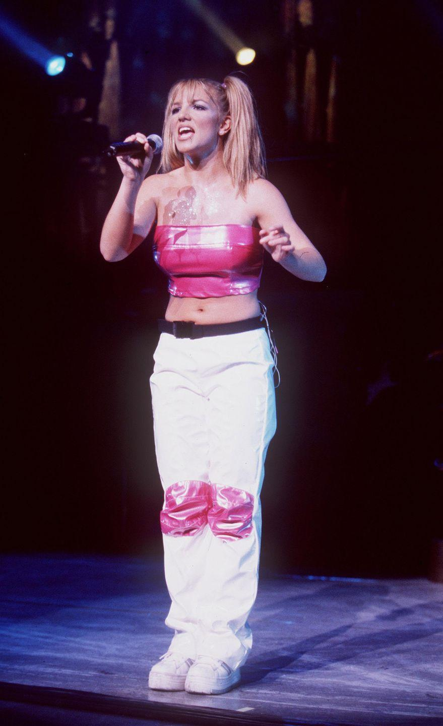 """<p>Britney Spears performs during her """"Baby One More Time"""" tour in Universal City, California, on July 31, 1999.</p>"""