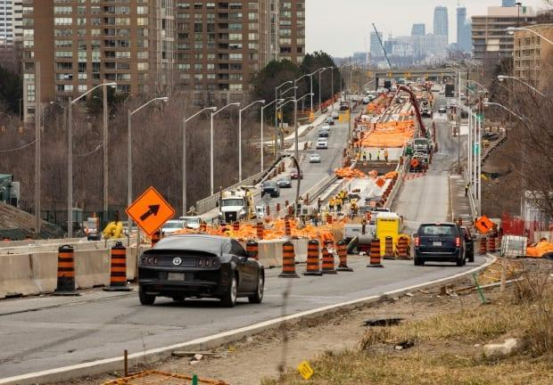 Construction work along Eglinton Avenue, where a new 19-kilometre light-rail transit line is facing another possible delay in its opening. (Michael Wilson/CBC - image credit)