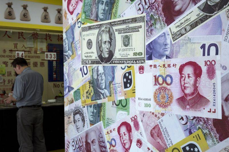 A customer is served at a counter at a foreign exchange store in Hong Kong