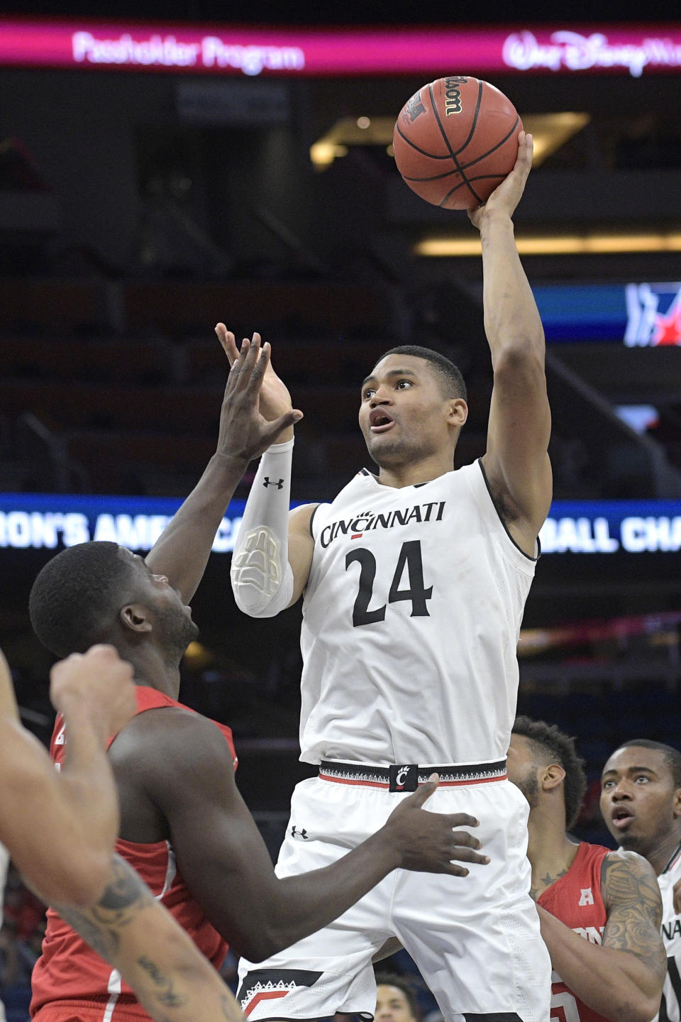 Cincinnati forward Kyle Washington (24) goes up to shoot in front of Houston forward Nura Zanna (13) during the first half of an NCAA college basketball championship game at the American Athletic Conference tournament Sunday, March 11, 2018, in Orlando, Fla. (AP Photo/Phelan M. Ebenhack)