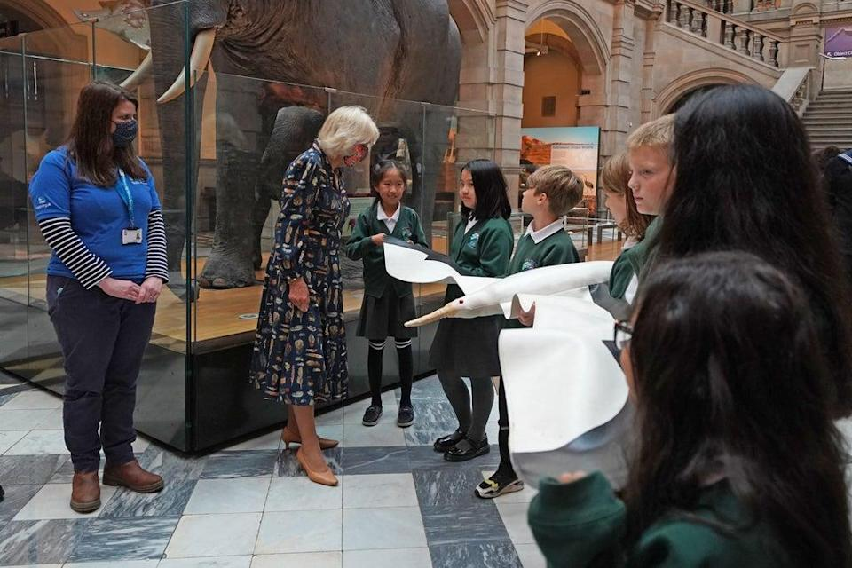 The Duchess of Cornwall (second left) talks to school children as they hold a model of an albatross during a visit to Kelvingrove Art Gallery and Museum in Glasgow (Andrew Milligan/PA) (PA Wire)