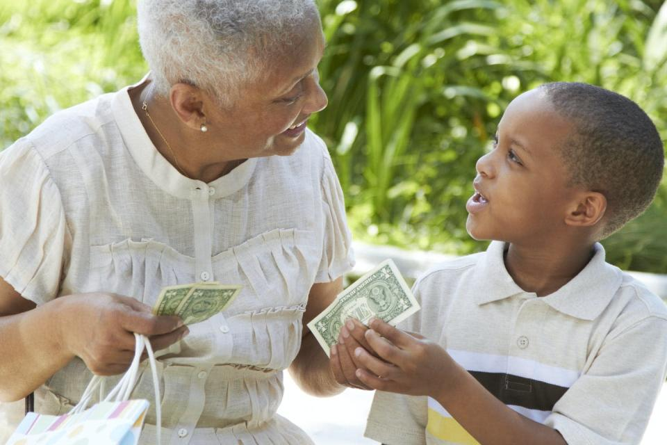 "<span class=""caption"">Cash is unlikely to give you the coronavirus.</span> <span class=""attribution""><a class=""link rapid-noclick-resp"" href=""https://www.gettyimages.com/detail/photo/african-american-grandmother-handing-money-to-royalty-free-image/142018467?adppopup=true"" rel=""nofollow noopener"" target=""_blank"" data-ylk=""slk:Rolf Bruderer/Getty Images"">Rolf Bruderer/Getty Images</a></span>"