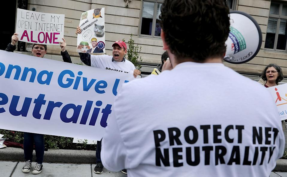 Proponents of net neutrality protest against Federal Communication Commission Chairman Ajit Pai outside the American Enterprise Institute/Getty Images