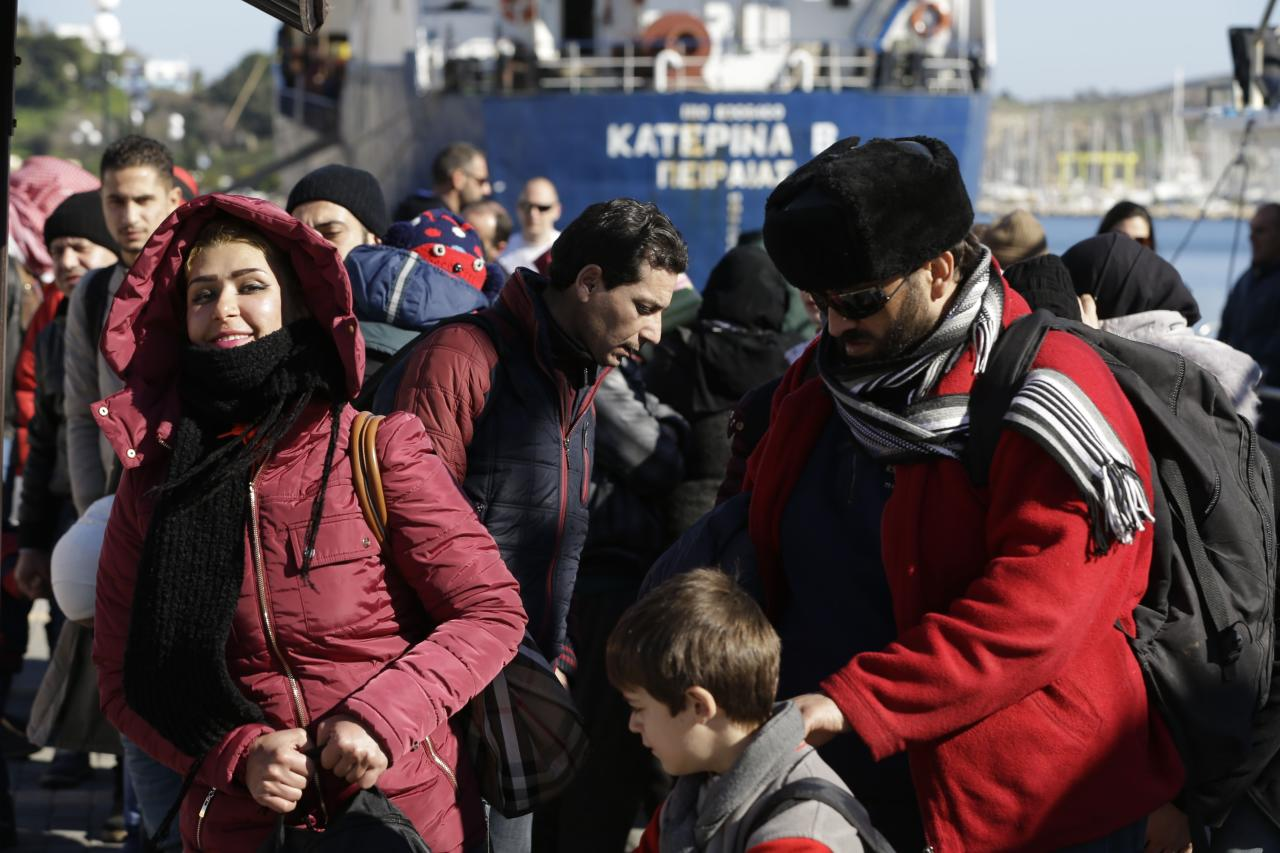 Migrants and refugees arrive at a refugee camp at Lakki port, after being picked up from an islet, near the southeastern Greek island of Leros, Tuesday, Feb. 2, 2016. The International Organization for Migration says more than 62,000 people crossed the Aegean in January — over 90 percent of them from Syria, Afghanistan and Iraq — and 272 died on that route. Another 5,000 people crossed the central Mediterranean from Libya to Italy. (AP Photo/Thanassis Stavrakis)