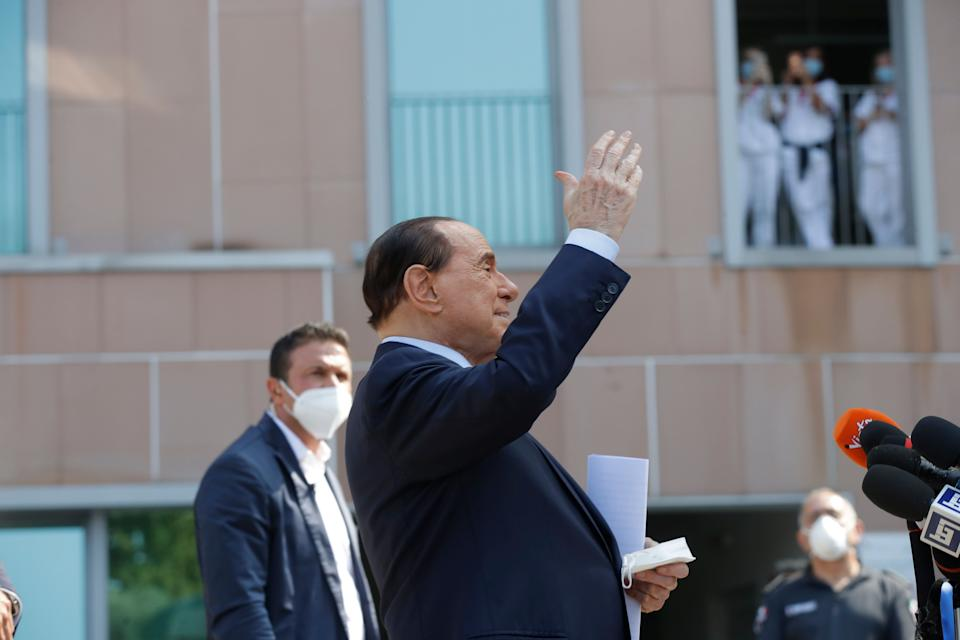 "Italian former Premier Silvio Berlusconi waves as he leaves the San Raffaele hospital in Milan, Italy, Monday, Sept. 14, 2020. Former Premier Silvio Berlusconi has been released from the hospital after what he says was an ""insidious"" bout with COVID-19. Wearing a suit and smiling, the 83-year-old Berlusconi said doctors at San Raffaele hospital in Milan told him he had the highest levels of virus they had seen in the tens of thousands of samples they had taken over the past six months. (AP Photo/Luca Bruno) (Photo: ASSOCIATED PRESS)"