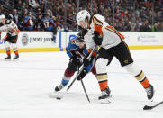 Anaheim Ducks left wing Rickard Rakell (67) attempts to gain control of the puck Colorado Avalanche center Tyson Jost (17) moves in during the second period in an NHL hockey game Wednesday, March 4, 2020 in Denver. (AP Photo/John Leyba)