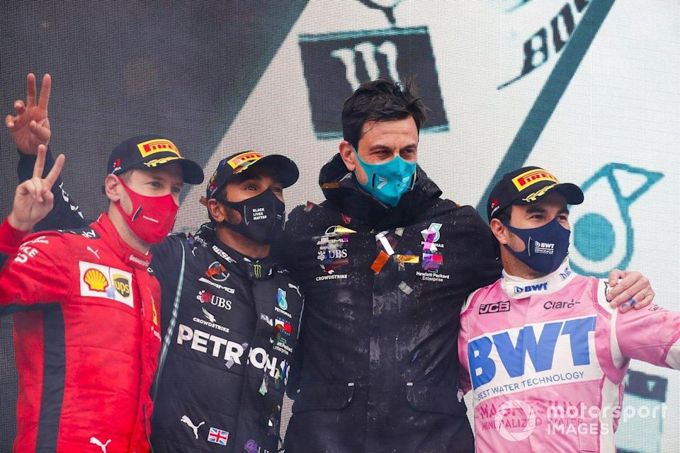 "Sebastian Vettel, Ferrari, Race Winner Lewis Hamilton, Mercedes-AMG F1, Toto Wolff, Executive Director (Business), Mercedes AMG and Sergio Perez, Racing Point celebrate on the podium<span class=""copyright"">Steven Tee / Motorsport Images</span>"