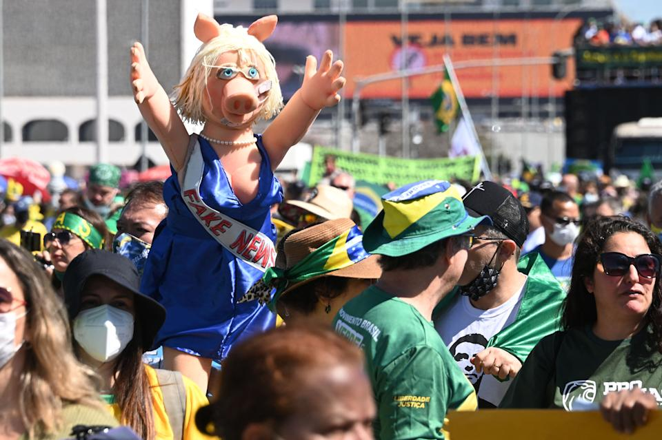 Demonstrators take part in a rally in support of Brazilian President Jair Bolsonaro and calling for a printed vote model at Esplanade of Ministries in Brasilia, Brazil on August 1, 2021. - Thousands of Brazilians took to the streets of Rio de Janeiro and Brasilia Sunday to support far-right President Jair Bolsonaro in protest against the country's electronic voting system. (Photo by EVARISTO SA / AFP) (Photo by EVARISTO SA/AFP via Getty Images)