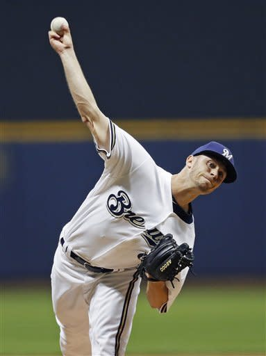Milwaukee Brewers' Tyler Thornburg pitches to a San Diego Padres batter during the first inning of a baseball game Tuesday, Oct. 2, 2012, in Milwaukee. (AP Photo/Tom Lynn)