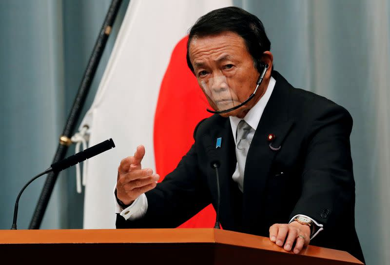 FILE PHOTO: Japan's newly-appointed Finance Minister Taro Aso speaks at a news conference in Tokyo