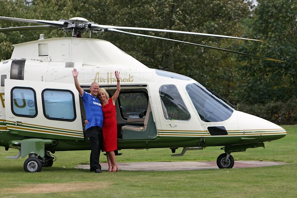 Dave and Angela Dawes from Wisbech, Cambridgeshire, wave as they leave Down Hall Country House Hotel in Hatfield Heath, Hertfordshire, after they won the UK's third biggest lottery prize - more than 101 million.