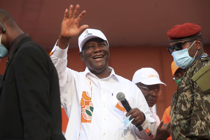 Ivory Coast President Alassane Ouattara cheers during his last rally in Abidjan, Ivory Coast, Thursday Oct. 29, 2020. Ouattara, who first came to power after the 2010 disputed election whose aftermath left more than 3,000 people dead, is now seeking a third term in office. Opposition candidate Henri Konan Bedie called for a boycott of the Oct. 31 election, complaining that the country's electoral commission is made up entirely of officials from the ruling party.(AP Photo/Diomande Ble Blonde)