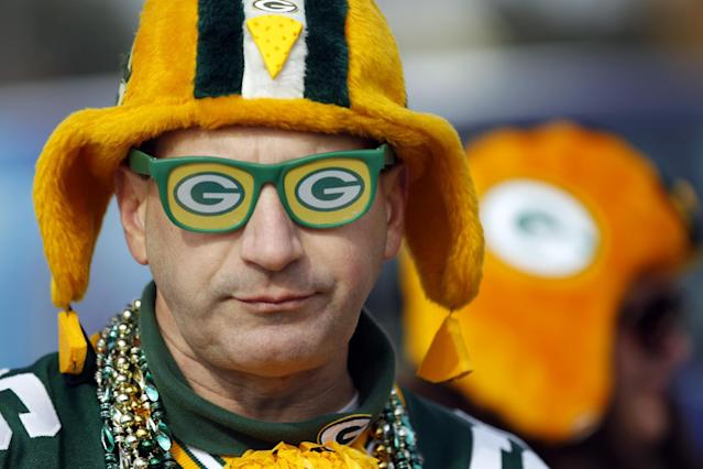 Green Bay Packers fan Jim Zanon tailgates before an NFL football game against the Cleveland Browns Sunday, Oct. 20, 2013, in Green Bay, Wis. (AP Photo/Mike Roemer)