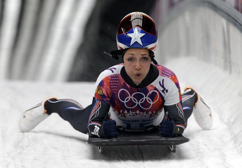 Katie Uhlaender of the United States brakes after her final run during the women's skeleton competition at the 2014 Winter Olympics, Friday, Feb. 14, 2014, in Krasnaya Polyana, Russia. (AP Photo/Dita Alangkara)
