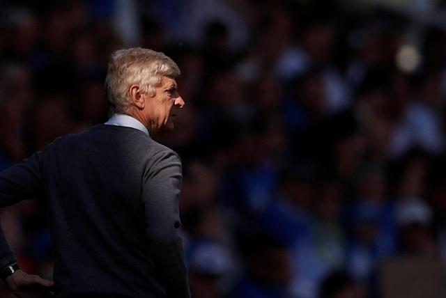 "Soccer Football - Premier League - Huddersfield Town vs Arsenal - John Smith's Stadium, Huddersfield, Britain - May 13, 2018 Arsenal manager Arsene Wenger looks on Action Images via Reuters/Andrew Boyers EDITORIAL USE ONLY. No use with unauthorized audio, video, data, fixture lists, club/league logos or ""live"" services. Online in-match use limited to 75 images, no video emulation. No use in betting, games or single club/league/player publications. Please contact your account representative for further details."