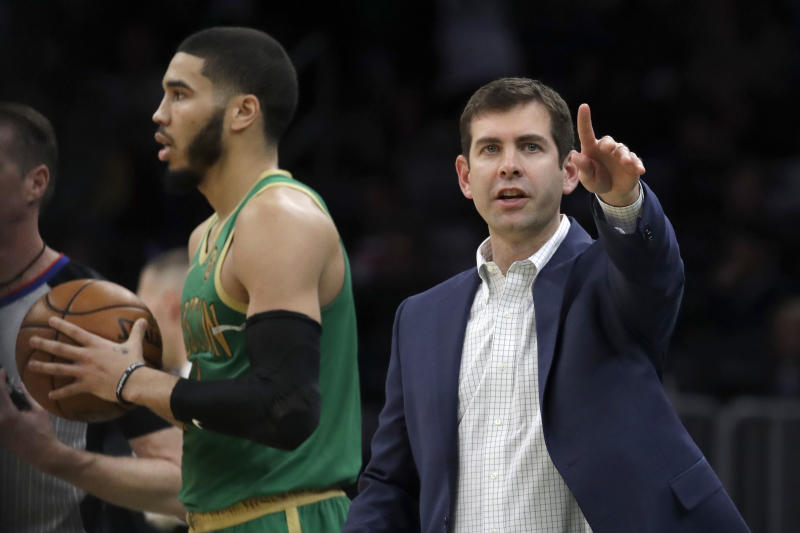 Boston Celtics head coach Brad Stevens, right, instructs his team as Celtics forward Jayson Tatum waits to inbound the ball in the second half of an NBA basketball game against the Denver Nuggets, Friday, Dec. 6, 2019, in Boston. (AP Photo/Elise Amendola)